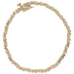 14 Karat Yellow and White Gold Link Bracelet with Diamond Accents