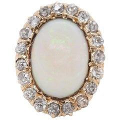 14 Karat Yellow and White Gold Oval Opal and 1 Carat Diamond Cocktail Ring