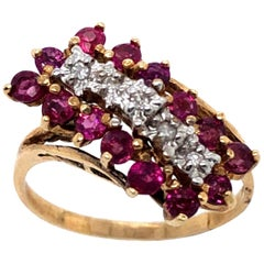 14 Karat Yellow and White Gold Ruby and Diamond Cluster Ring