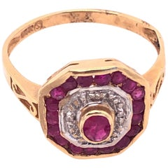 14 Karat Yellow and White Gold Ruby and Diamond Ring with Side Scroll