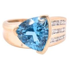 14 Karat Yellow Blue Topaz and Diamond Ring