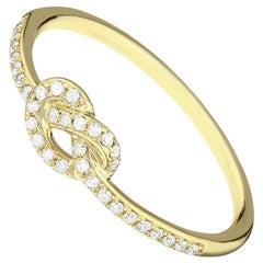 14 Karat Yellow Gold 0.107 Carat Knot Round Diamond Ring