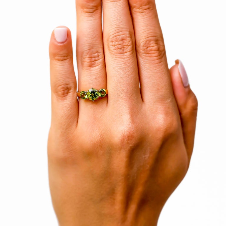 Contemporary 14 Karat Yellow Gold 0.2 Carat Diamond 2 Carat Peridot Three-Stone Ring