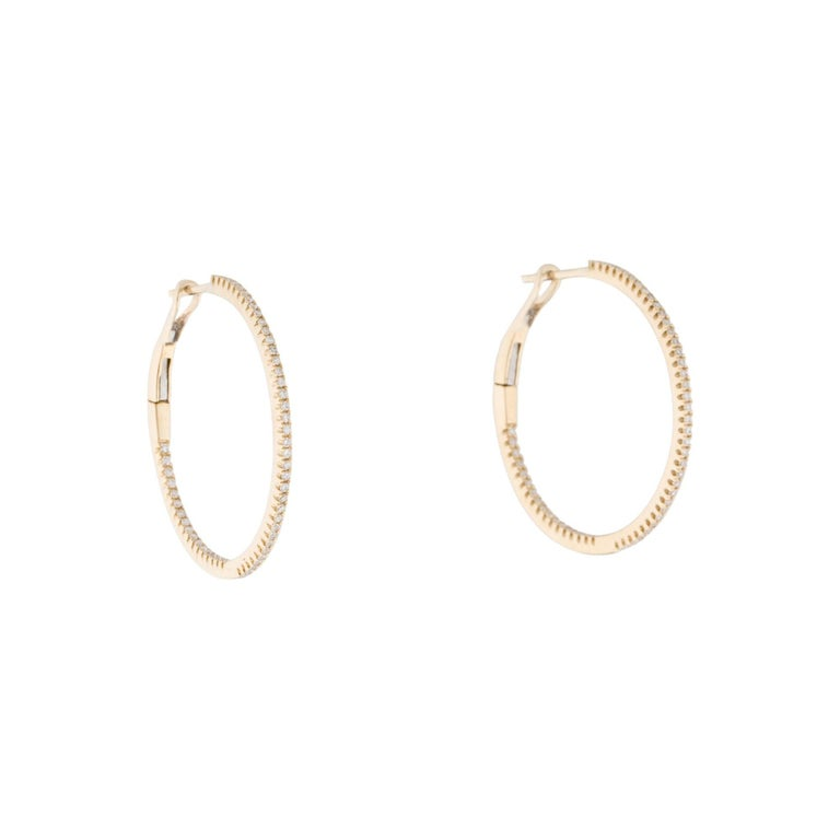 Light up your favorite looks with the brilliance of diamonds! Shimmering and bright, these gorgeous narrow round hoops glisten with approximately 0.30ct diamonds along the outer edge. Diamond color and clarity is GH SI1-SI2. Lever backs provide a