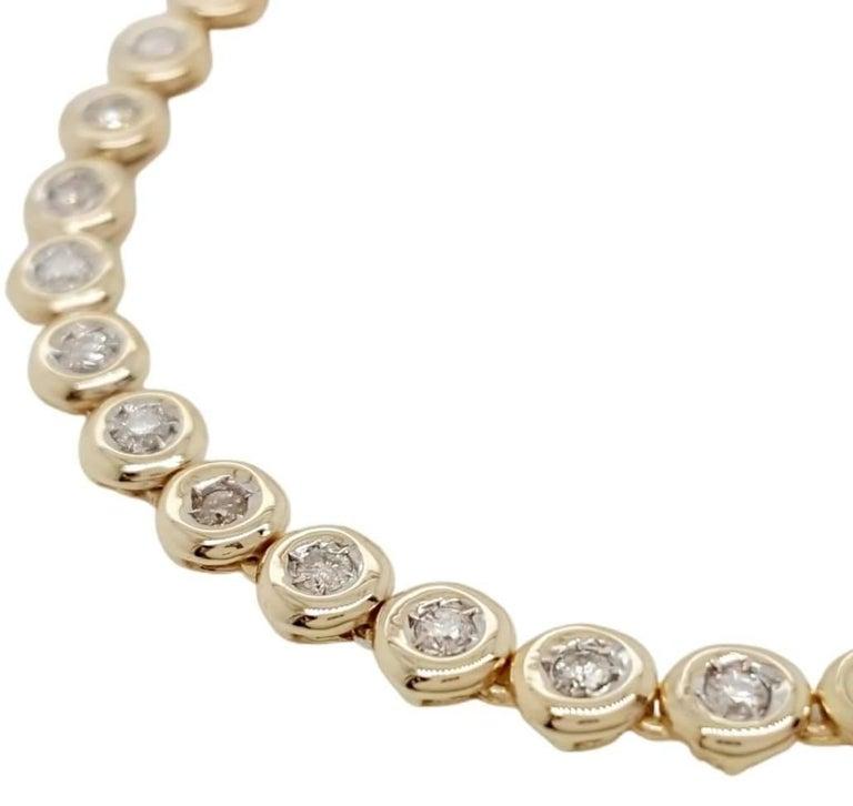 Contemporary 14 Karat Yellow Gold 1 Carat Round Diamond Bezel Set Tennis Bracelet For Sale