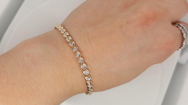 14 Karat Yellow Gold 1 Carat Round Diamond Bezel Set Tennis Bracelet In Excellent Condition For Sale In Addison, TX