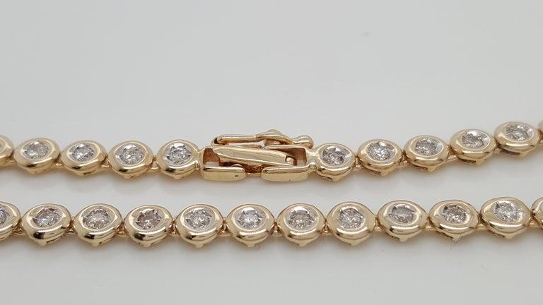 14 Karat Yellow Gold 1 Carat Round Diamond Bezel Set Tennis Bracelet For Sale 2