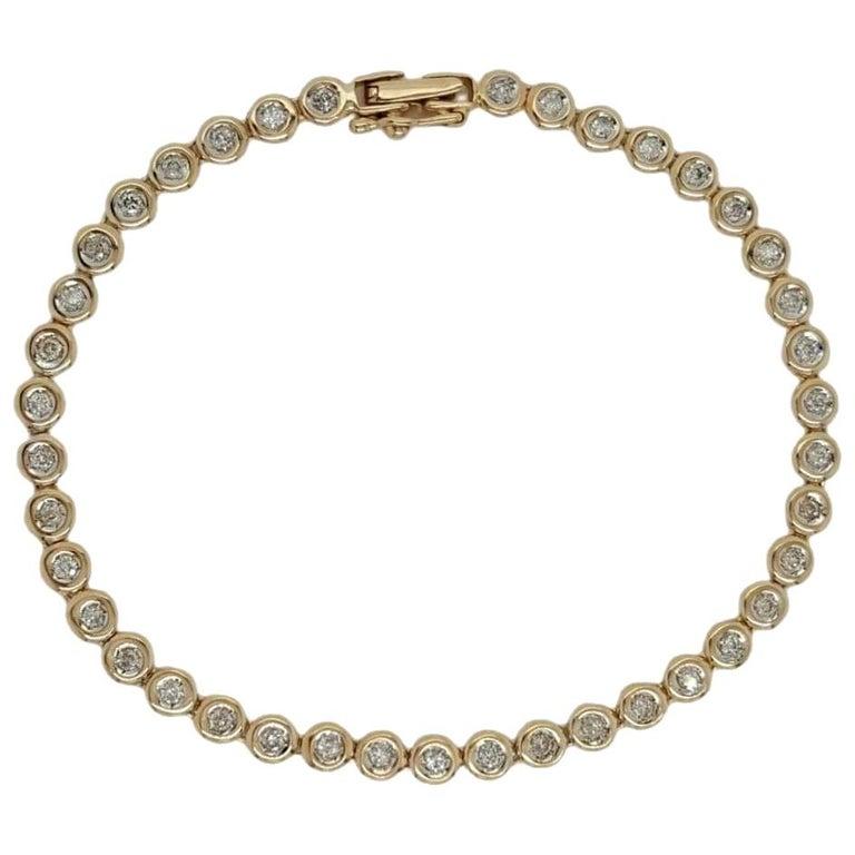 14 Karat Yellow Gold 1 Carat Round Diamond Bezel Set Tennis Bracelet For Sale