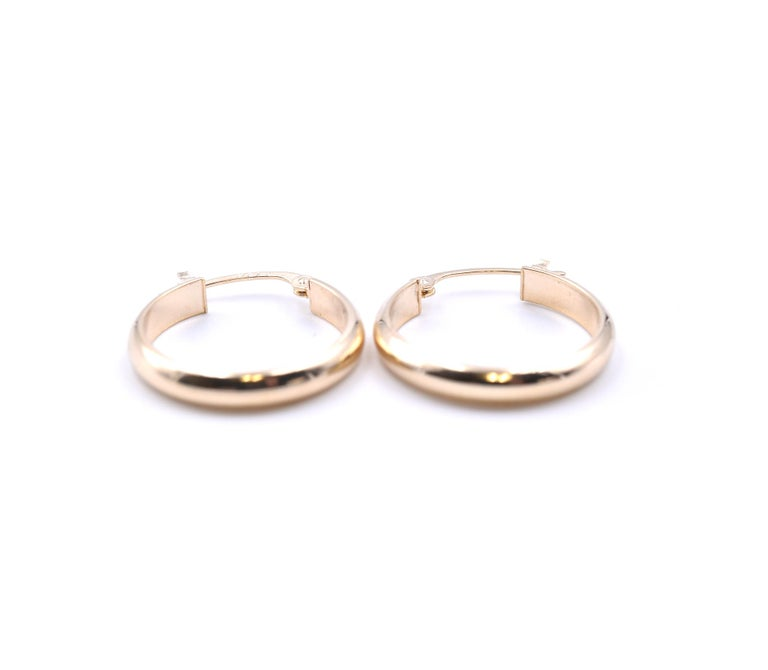 Designer: custom Material: 14k yellow gold Dimensions: earrings measure 17mm in diameter Fastenings: snap closure Weight: 1.01 grams