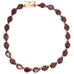 14 Karat Yellow Gold Fancy Link Garnet Bracelet