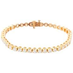 14 Karat Yellow Gold 6.21 Diamond Tennis Bracelet