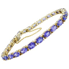 14 Karat Yellow Gold 7.25 Carat Tanzanite Tennis Line Bracelet