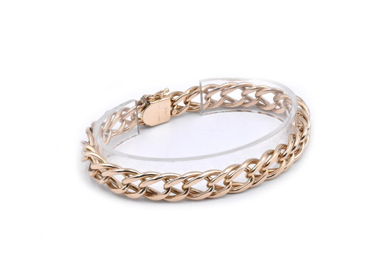 Designer: custom  Material: 14k yellow gold Dimensions: the bracelet will fit up to an 8 -inch wrist Weight: 36.7 grams