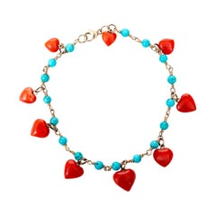 14 Karat Yellow Gold and Coral Heart Charm Bracelet