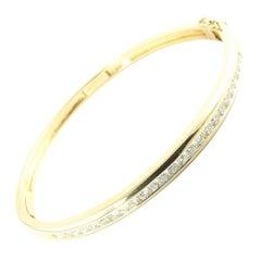 14 Karat Yellow Gold and Diamond Bangle Bracelet