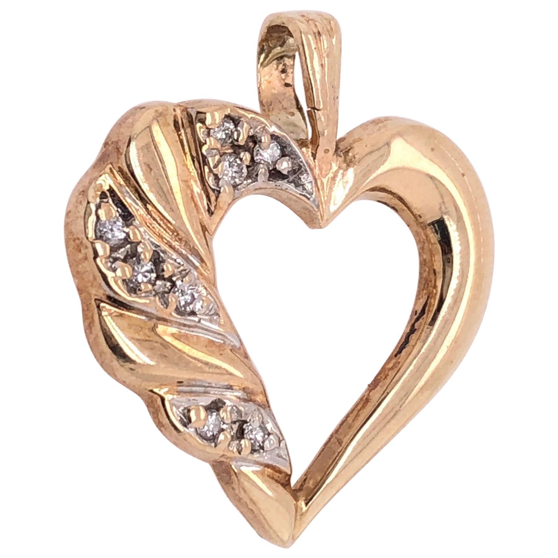 14 Karat Yellow Gold and Diamond Heart Pendant / Charm