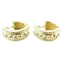 14 Karat Yellow Gold and Diamond Huggie Earrings