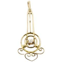 14 Karat Yellow Gold and Diamond Pendant