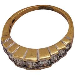 14 Karat Yellow Gold And Graduating Nine Diamond Anniversary Ring 1.00 TDW