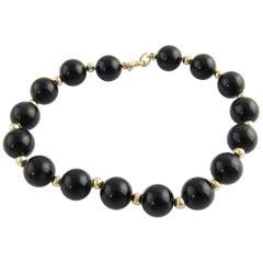 14 Karat Yellow Gold and Onyx Bead Bracelet