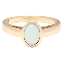 14 Karat Yellow Gold and Opal Solitaire Bezel Ring