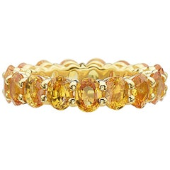 14 Karat Yellow Gold and Yellow Sapphire Eternity Band Ring