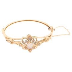 14 Karat Yellow Gold Bangle Bracelet with Center Opal and Diamond Accents