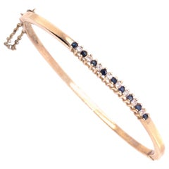 14 Karat Yellow Gold Bangle Bracelet with sapphires and Diamonds