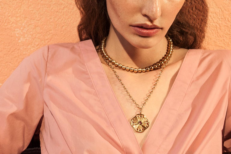 From the American Southwest and beyond, This elegant yet edgy 14 karat yellow gold Marlo Laz Squash Blossom bead collar allows you to carry the serenity and the mystic of the desert with you, wherever you go. Cast in a hue of gold as warm of the sun