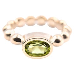 14 Karat Yellow Gold Bezel Set Peridot Ring
