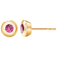 14 Karat Yellow Gold Bezel Set Ruby Stud Earrings Weighing 0.30 Carat