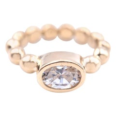 14 Karat Yellow Gold Bezel Set White Topaz Ring