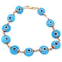 14 Karat Yellow Gold Blue Ceramic Evil Eye Charm Bracelet