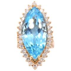 14 Karat Yellow Gold Blue Topaz and Diamond Cocktail Ring