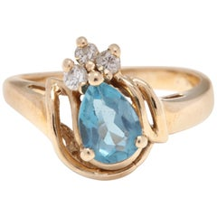 14 Karat Yellow Gold, Blue Topaz and Diamond Ring
