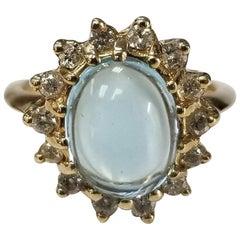 14 Karat Yellow Gold Blue Topaz Cabochon and Diamond Ring