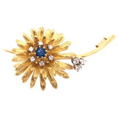 14 Karat Yellow Gold Brooch Pin Center Sapphire and Surrounding Diamonds