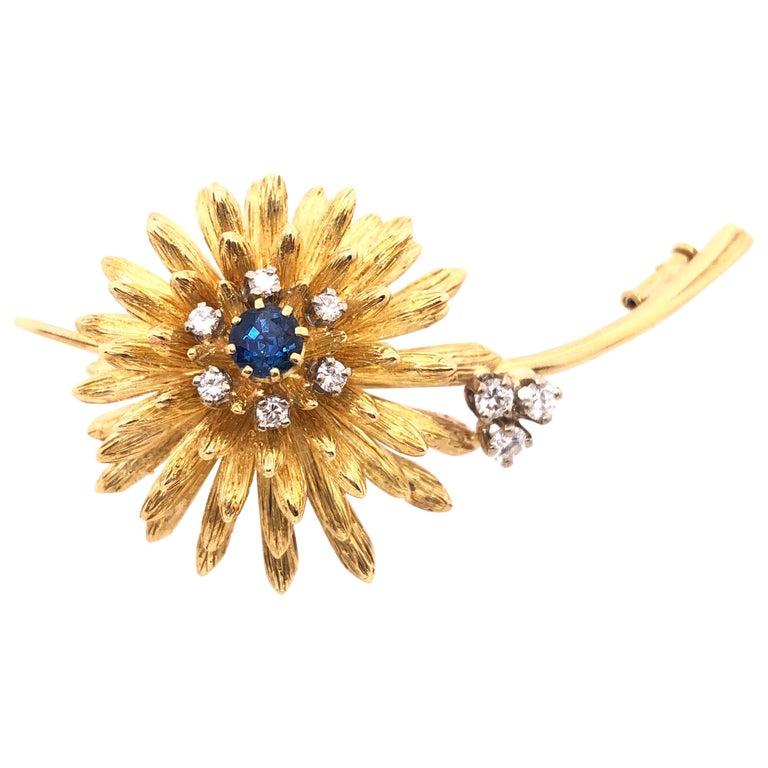 14 Karat Yellow Gold Brooch Pin Center Sapphire and Surrounding Diamonds For Sale