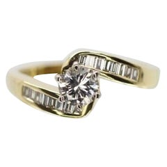 14 Karat Yellow Gold Bypass Baguette and Round Diamond Engagement Ring