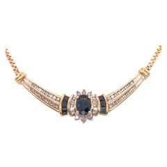 14 Karat Yellow Gold Cable Necklace with Oval Sapphire 1.00 Total Diamond Weight