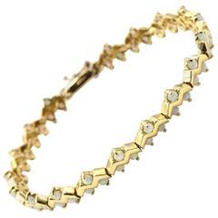 14 Karat Yellow Gold Cabochon Opal Zig Zag Tennis Bracelet