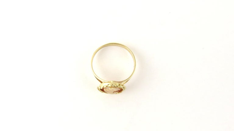 Vintage 14 Karat Yellow Gold Cameo Ring Size 4.75  This lovely cameo ring features lovely lady in profile framed in beautifully detailed 14K yellow gold. Cameo measures 12 mm x 11 mm. Shank measures 2 mm.  Ring Size: 4.75  Weight: 0.7 dwt. / 1.2