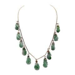 14 Karat Yellow Gold Carved Jade Drop Necklace