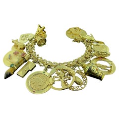 14 Karat Yellow Gold Charm Bracelet with 19 Charms