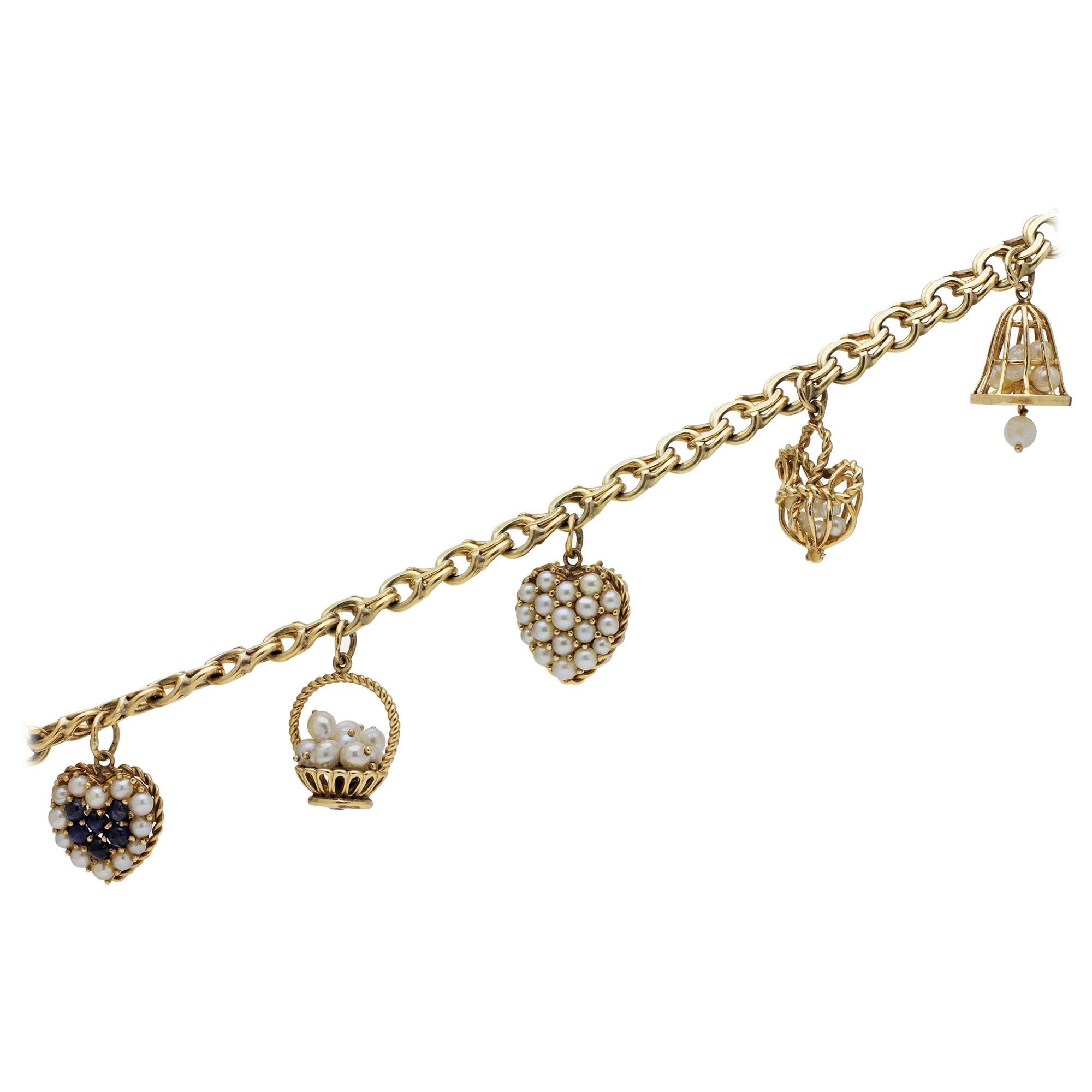14 Karat Yellow Gold Charm Bracelet with Pearls and Ceylon Sapphires