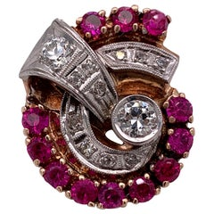 14 Karat Yellow Gold Cocktail Ring with Diamonds and Rubies in a Swirl Pattern