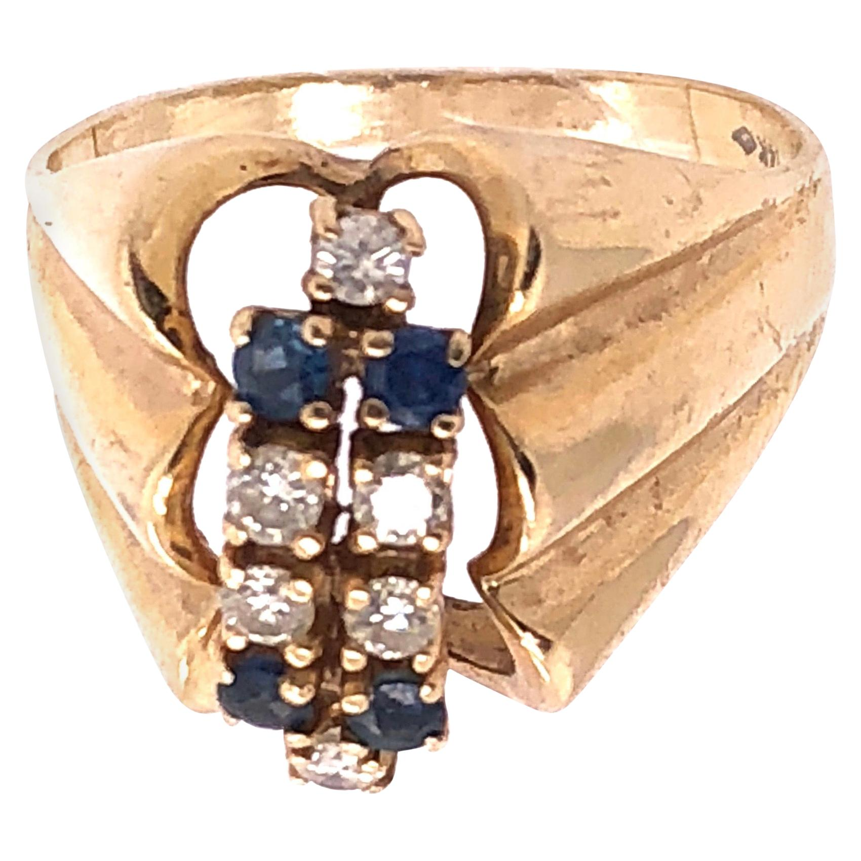 14 Karat Yellow Gold Contemporary Ring with Sapphire and Diamonds