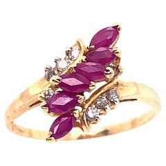 14 Karat Yellow Gold Contemporary Ruby Ring with Diamond Accents