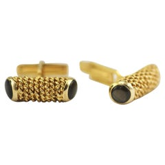 14 Karat Yellow Gold Cufflinks Beautifully Accented with 4 Black Star Sapphires