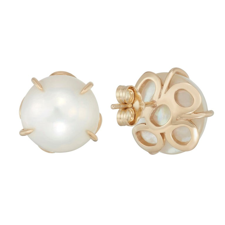Not just your ordinary pearl earrings, these bold round lustrous Mabe (pronounced May-Bay) pearls are prong set with Hi June Parker's signature organic circular elements on the back. Wear them with your hair up or down, for any occasion to celebrate